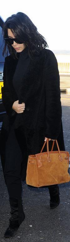 Kim Kardashian: coat – Calvin Klein  Purse – Hermes  Sunglasses – Saint Laurent  Shoes – Guiseppe Zanotti