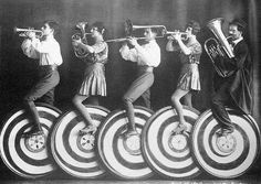 ♕ Vintage Costume Variations ♕  Circus band riding unicycles decorated like peppermint candies. Cirque Vintage, Vintage Circus Photos, Vintage Photographs, Vintage Images, Funny Vintage, Old Circus, Circus Art, Night Circus, Circus Theme