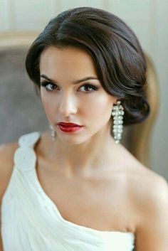 Sleek brunette updo More