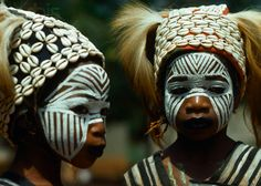 Africa | Girls wear face paint and a ritual headdress during the performance of a traditional dance drama. Pays Yacouba, Ivory Coast. | © Charles & Josette Lenars/Corbis