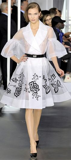 WANT!!!  White w/black rose embroidery. Short skirt, full bell sleeves.   Dior Haute Couture SS 2012