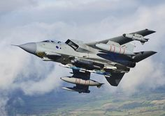 """RAF deployed Tornado GR4s in support of air campaign over northern Iraq,British officials said 12/8/14.Stressed would be part of humanitarian operations,but deployment nonetheless sparked speculation Britain might soon join US in launching airstrikes.A """"small number of aircraft"""" fitted with Litening III reconnaissance pods flew out of Norfolk Tuesday.Deployed to Cyprus,where will be """"available to fly over area at short notice to provide vital intelligence to assist delivery"""" of humanitarian…"""