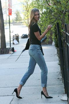 Karlie Kloss in cuffed jeans, a T-shirt, and heels