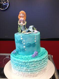 Mermaid birthday cake with ruffles.