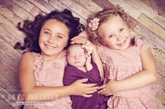 Gorgeous sibling with newborn pose. by alyssa