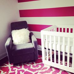 Fuchsia and White Striped Accent Wall - such a bold statement in the nursery!