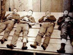 A post-death photo, known as a memento mori, of the Dalton Gang, (from left) Bill Power, Bob Dalton, Grat Dalton, and Dick Broadwell.