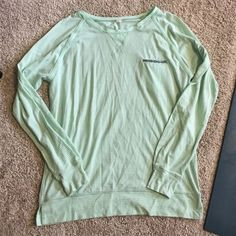 Lululemon long sleeve Great condition worn a few times. No trades. Mint color, very soft great for throwing over after yoga! lululemon athletica Tops