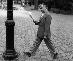Comedian Jacques Tati photographed in NYC for Glamour magazine, 1954.