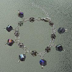 Purple glass and flower bracelet flower by BlueBubbleCrystals