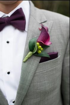 Grooms attire. Grey suit, eggplant bow tie and pocket square. Eggplant callalily