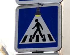 Street art in Europe, Traffic signs altered with stickers to make humorous images, Clet Abraham, Graffiti