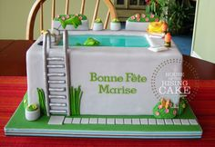 Take a dip in this superb garden-side swimming pool cake at your next summer get-together.