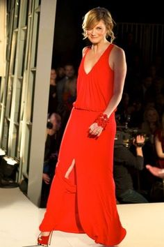 Sugarland's Jennifer Nettles looking stunning on the catwalk in a red dress for the Red Dress Collection Fashion Show.