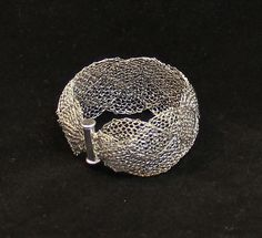 Wire knit from Stainless steel wire.  Wow - I would this this would be hard wire to work with!  Beautiful.