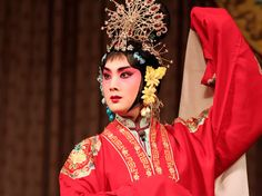 The distinctive 'Beijing Opera' style became prominent in China in the late 19th century. Performers wore striking make-up and bright costumes to show the personalities and status of their characters. Rather than acting 'realistically', Beijing opera performers  'symbolic' movements.