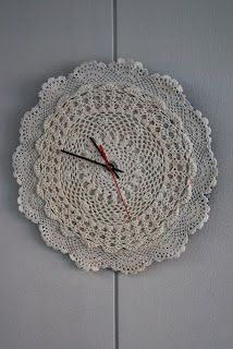 Clock made of doilies. I could do this easily with a clock kit from the craft store.