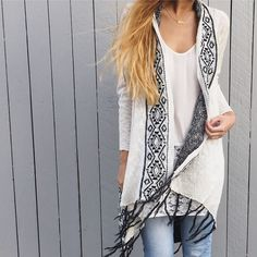 | new | white long fringe cardigan offers welcome new with tag white and black fringe trim cardigan with angled hem. available in size medium and large. •560998•  instagram: @xomandysue Sweaters Cardigans