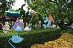 """[RIDE / WISH] MAD TEA PARTY (click to read a short review) Sometimes the Mad Hatter himself, Alice or the White Rabbit make an appearance throughout the day for meet and greets and even join """"in"""" a cup of tea with some lucky guests. *It's super fun to spin as fast as you can. *Try going at night too cause it all lights up and is a swirl of colorful light."""