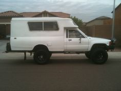 1985 4x4 Turbo Diesel Toyota longbed that has been converted into a camper by removing the bed and the addition of the pop-top camper off of a 1978 Toyota Chinook.
