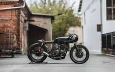 This second collection bike is a pure black urban racer based on a 1973 Honda CB550.    Honda Custom Motorcycle Cafe Racer #caferacer