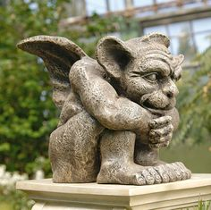 Emmett the Gargoyle Sculpture~one of the original medieval creatures that pensively perched from European rooftop and turret. Our historic, muscular fellow is cast in quality designer resin with an aged and weathered dark greystone finish for true authenticity.