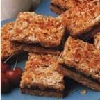 Oatmeal Dream Dates - A dream of a cookie bar loaded with oats, dates, coconut and nuts in an orange and brown sugar base.