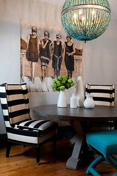 The conteporary wing chair in horizontal black and white stripes is stunning with this chandelier and vintage artwork Rachel Reider Interior Designs