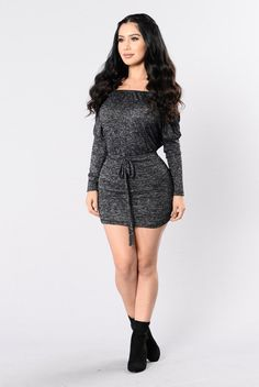 - Available in Black - Mini Dress - Drawstring Detail - Mid Sleeve - Made in USA - Polyester/Acrylic/Spandex