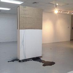 SHIVA ALIABADI   <p><em>Spill</em>, Site-specific installation using mobile gallery wall, burlap, ink, copper pins</p>