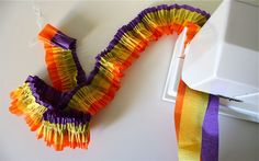 Layered ruffled streamers. Great for any occasion but especially festive for mine :-)  http://www.danamadeit.com/2011/05/tutorial-ruffled-streamers.html