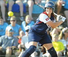 THE USA SOFTBALL TEAM'S Nicole Hudson eyes an incoming pitch during Tuesday night's exhibition doubleheader against a team of Ohio college a...