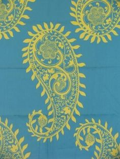 Outstanding allover repeat paisley pattern on a rich sea blue background with accents in yellow.  Beautiful Fabric.com