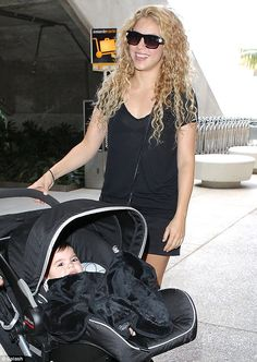 Baby love! Shakira, pictured here with baby Milan at LAX last week, cannot help but share adorable snaps of her firstborn at any opportunity