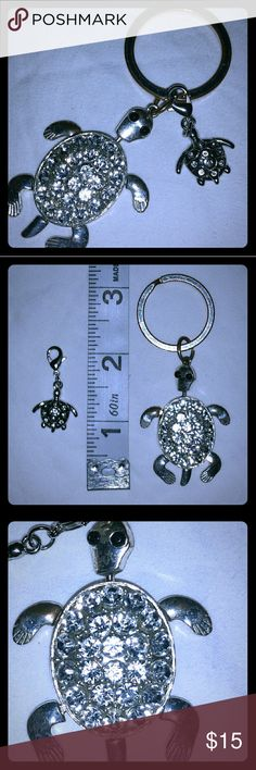 "Sparkly Turtle Key Chain & Turtle Charm Set Sparkly Cute Turtles:  Silver-toned & Clear Rhinestones Turtle Key Chain w/Keyring: the turtle has Black Rhinestone Eyes & it's legs & head move. Tiny Silver-toned & Clear Rhinestones Turtle Charm w/Lobster Clasp. Both Turtles have Rhinestones that are Very Sparkly & eye-catching. Key Chain Turtle Measures 2""long, w/ Key Ring measures about 3.25"" long. The Charm Turtle measures about 1"" long w/clasp & 1/2"" long w/out clasp. Selling as Set, NWOT…"