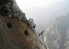 Mt. Hua, China trail. All you get is foot holes and a rusty chain to climb up and down.