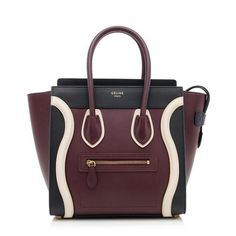 From the Winter 2015 Collection, this iconic Celine Micro Luggage tote is made from smooth calfskin in the burgundy, black, and off-white colorway. Details include two rolled handles, antique gold-tone hardware, a front pocket, and zip closure. The interior is fully lined in burgundy lambskin with two open pockets and one zippered pocket.