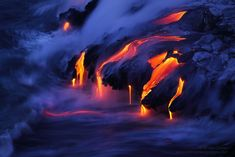 A mesmerizing display of pahoehoe dripping into the sea at the Kamokuna ocean entry creates the newest land on the planet | Bruce Omori. [20001334] xpost /r/LavaPorn. #reddit