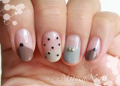 Nail art in neutral colors.