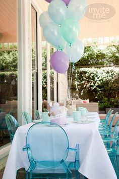 Mermaid beach party, products, styling and paperie by inviteme.com.au. Photography: White Sparks Photography  Replica ghost chairs by Little Chair (Melbourne)