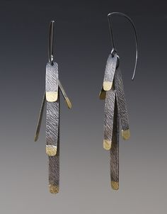 """""""Pine Needle Earrings""""  Gold & Silver Earrings  Created by Heather Guidero - Tipped with 18k gold, five slender strips of textured, oxidized sterling silver hang from sterling silver ear wires like pine needles on a branch. $395.00"""