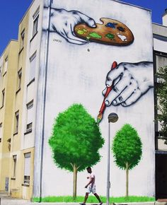 by Zabou in Loures, Portugal, 6/15 (LP) #streetart Love the design & bright colors! It inspires me to painting somewhat similar but different,some ways&every artist has their own authentic style.I would have tree branches shown more but still have leaves, preferably fall hue leaves on east coast,all branches connected, then I would have more than 1 person walking by;1 to represent each branch of community of minority's artists;with wanting to state no person in C.M.A. is alone,community of…