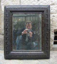 Beautifil mirror in #ebony #LouisXIII with its original mercury #beveled mirror. #17th century. For sale on Proantic by Antiquités Guillaume Duchemin.