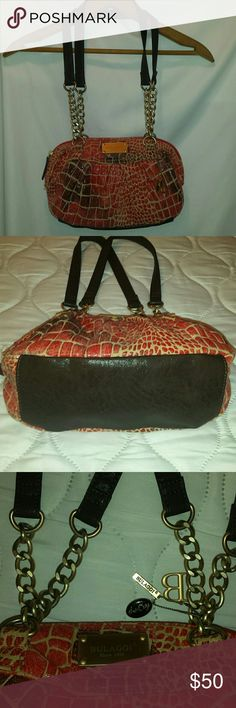 """NWOT Bulaggi """"the Bag"""" Really cool bag is 7""""x12"""". Strap is 12"""" from shoulder to top of bag. We have not been able to find another Bulaggi bag like it anywhere on the internet. Bulaggi Bags"""