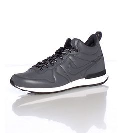 b41b72d2d06 NIKE Low top men s sneaker Reflective lace up closure Perforated throughout  for ventilation NIKE swoosh on sides NIKE lettering on heel Cushioned sole