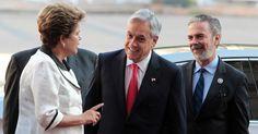 26/jan/2013 - CHILE - Presidentes do Brasil, Dilma Rousseff, e do Chile, Sebastian Piñera, conversam em frente ao palácio La Moneda, em Santiago, antes de encontro da cúpula de chefes de Estado e de governo da Comunidade de Estados Latino-americanos e Caribenhos (Celac) e da União Europeia (UE). Andres Stapff/Reuters.