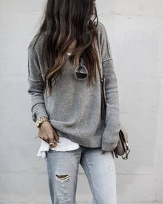Aylin is wearing distressed grey denim jeans with a white top and grey ribbed sweater, creating a comfortable and casual everyday style, perfect for spring. Sweater: Liketoknowit.