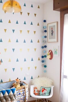 Baby G's Bright, Playful Space — Nursery Tour   Apartment Therapy. Like the triangles on wall.