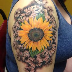 Grey Flower And Sunflower Tattoo On Right Shoulder