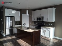 kitchen with granite countertops, slow closing hinges, pots and pans drawer, corner pantry at 5625 Glide Crescent, in Harbour Landing